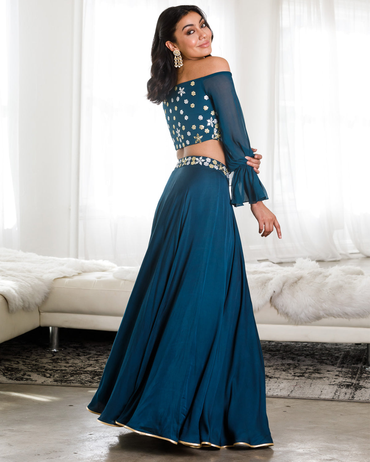 Teal Lehenga with gold and silver mirrored flowers