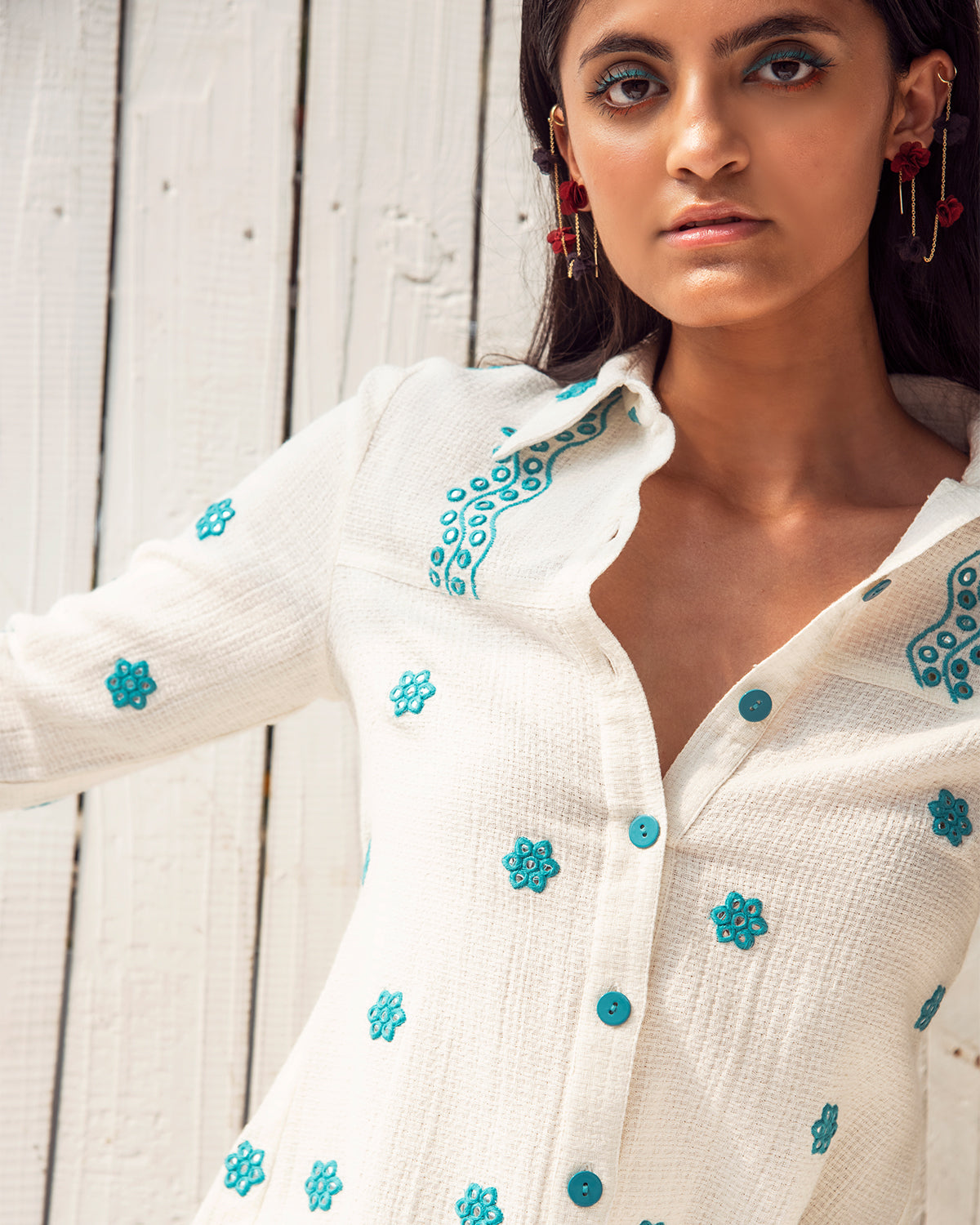 white button down with blue embroidery