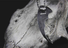 bat wing silver pendant on a cow skull