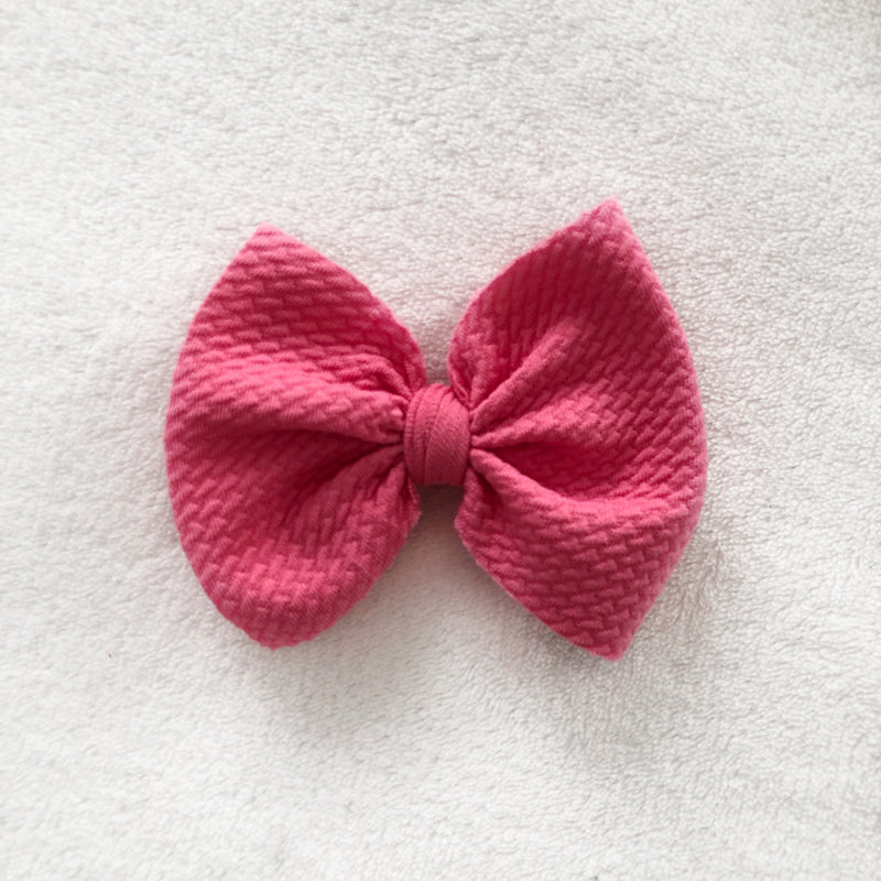 Barbie pink bow clip