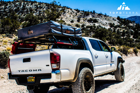 tepui kukenam roof top tent on top of all-pro roof rack in toyota tacoma