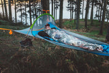 person chilling on a UNA Single Person Tree Tent - Lightest Tent Available - Ideal For Hikers - by Tentsile