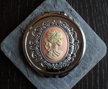 pink skeleton cameo compact mirror in silver delicate industry