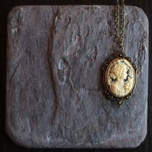 Small black cameo necklace in antique brass