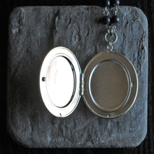 Large silver cameo locket