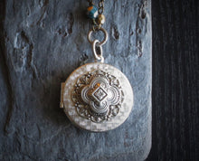 Silver quatrefoil locket