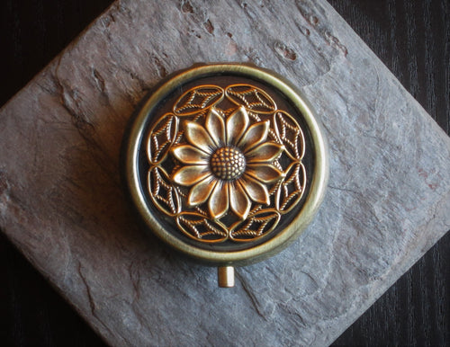 Bronze sunflower pill box