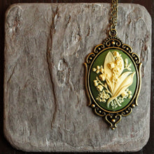 Green lily of the valley cameo necklace in antique brass