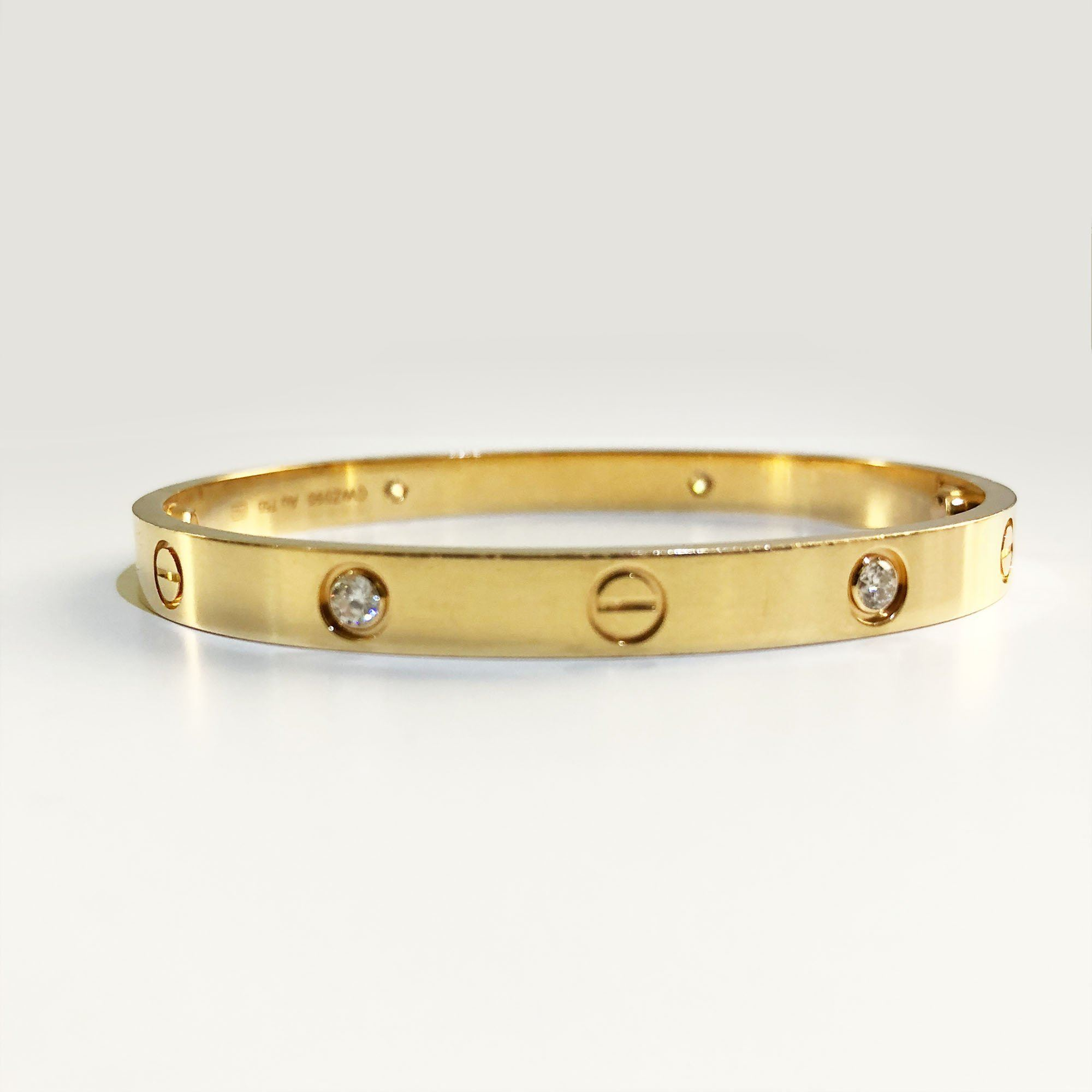 cartier love bracelet in yellow gold with 4 diamonds. Black Bedroom Furniture Sets. Home Design Ideas