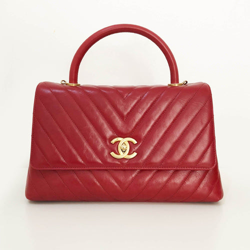 Chanel Aged Calfskin Chevron Quilted Coco Top Handle Bag