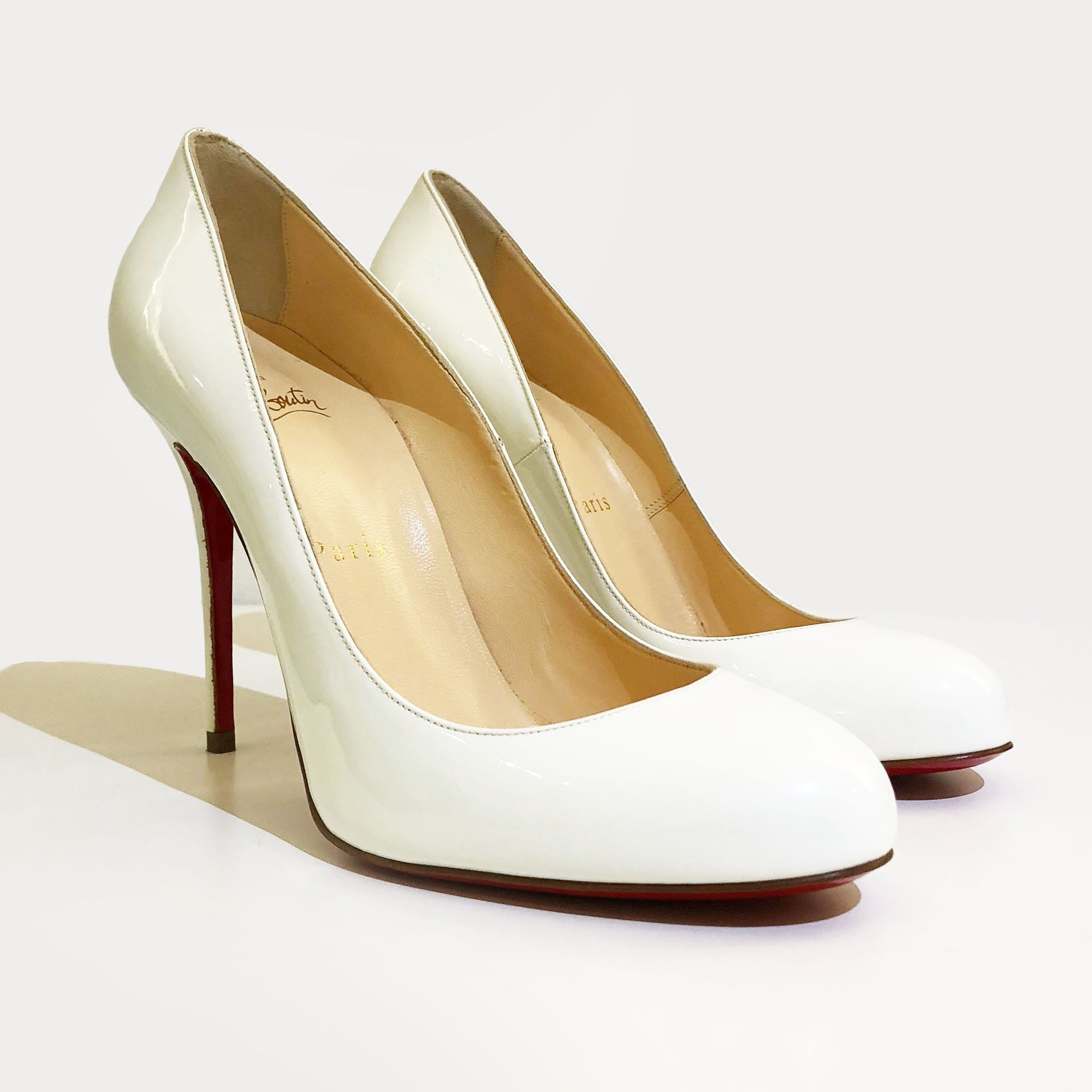 Christian Louboutin White Patent Leather Pumps