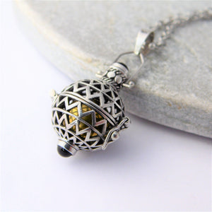 Round Sterling Silver Harmony Ball Locket with Garnets