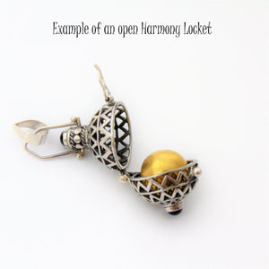 Open Harmony Locket with Brass Chime Ball placed inside
