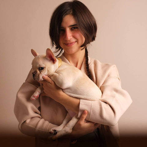 Kelsey McLeod Founder of déjà skincare holding french bulldog