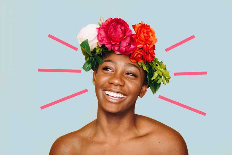Causes of Acne on Cheeks - clear faced woman smiling, wearing a flower crown