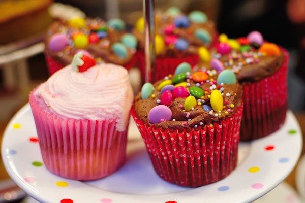 how to get rid of acne in 7 days naturally - cut out sugar. cupcakes on a platter with sprinkles