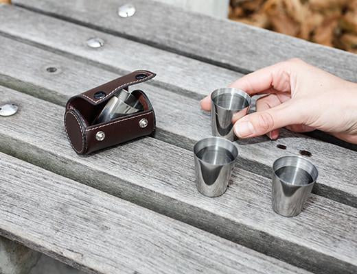 Steel shot glasses with leather pouch