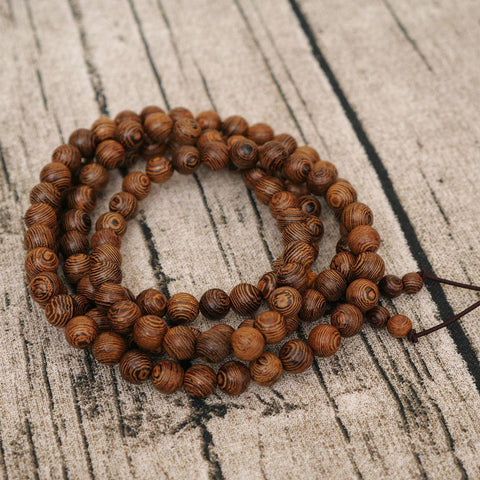 products/108-perles-8mm-De-Bois-De-Santal-Naturel-Bouddhiste-Bouddha-Bois-Pri-re-Perle-Mala-Unisexe_4.jpg