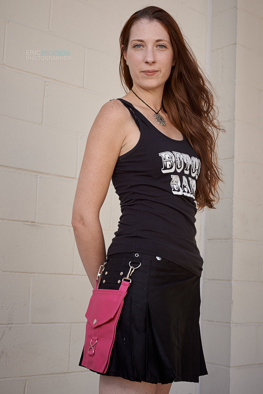 pink pocket, black kilt, tank top