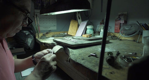 jeweler master working at bench