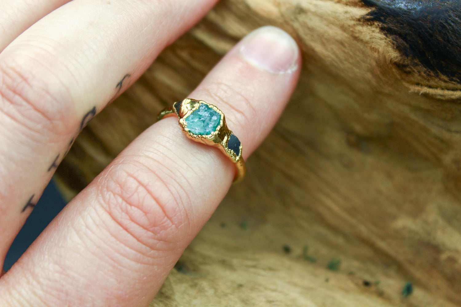 Tri-stone Emerald Ring in Yellow Gold