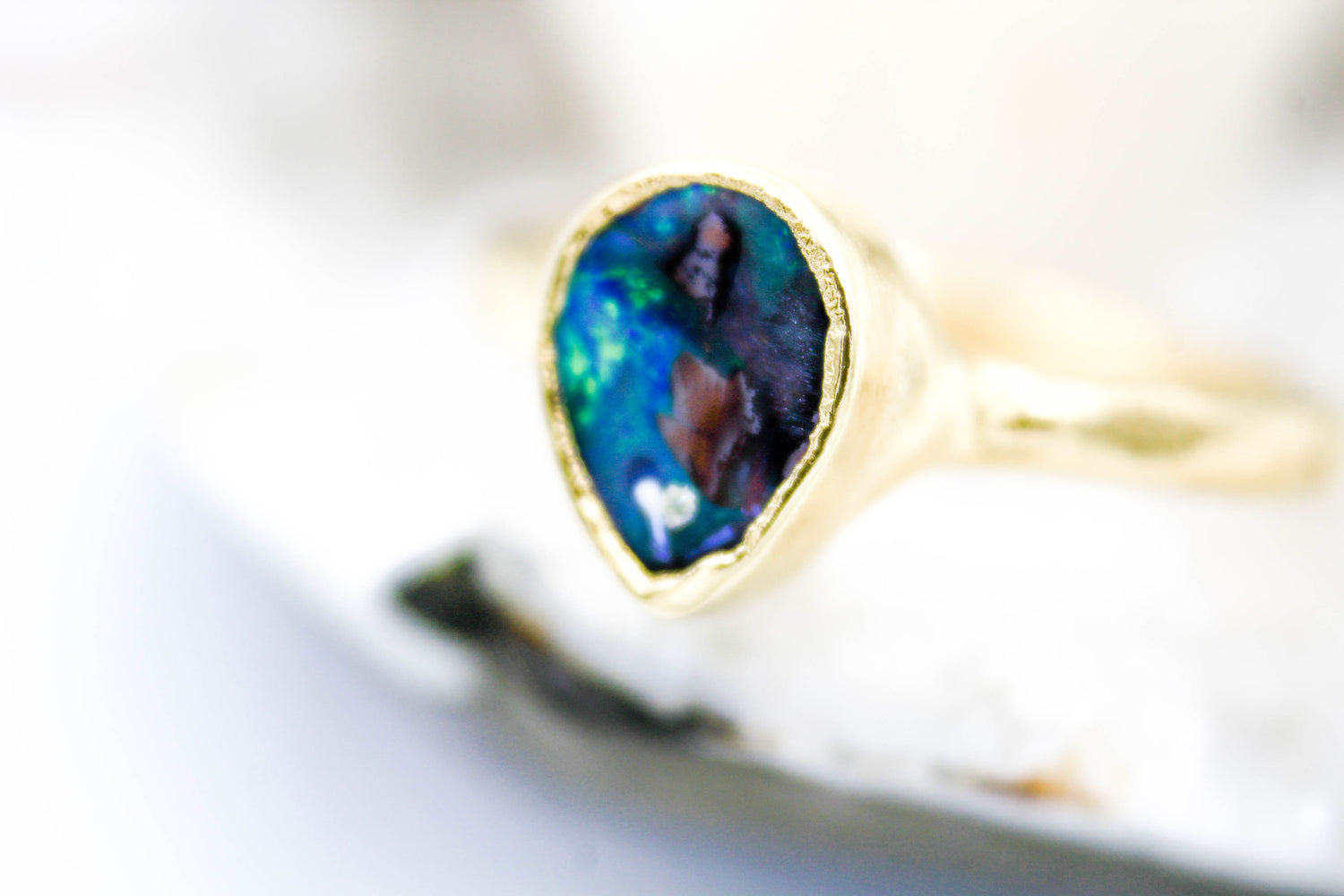 Natural Opal engagement ring by fox and stone custom bridal jewelers