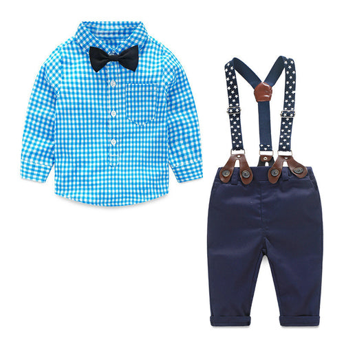 Blue checked shirt with bow tie and blue pants with suspenders.