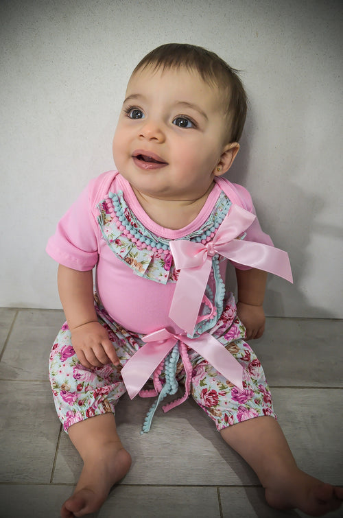 Pink short-sleeve romper with fabulous blue and pink tassel detail and matching easy-on floral pants with elasticated waist.