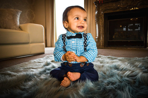 Baby boy shirt with bow tie and blue pants with suspenders.