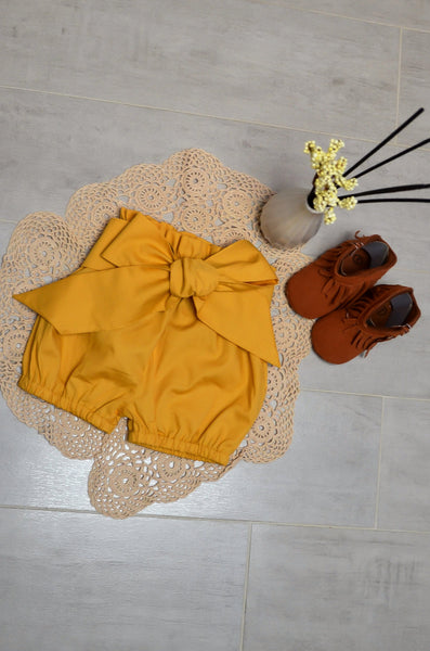 Plain mustard colour baby shorts with bow belt/headband. 2 piece set.