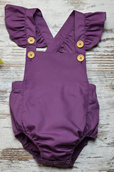 Plum vintage romper with adjustable frill sleeves.