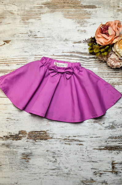 A-line skirt bright purple in colour with bow detail at the front.