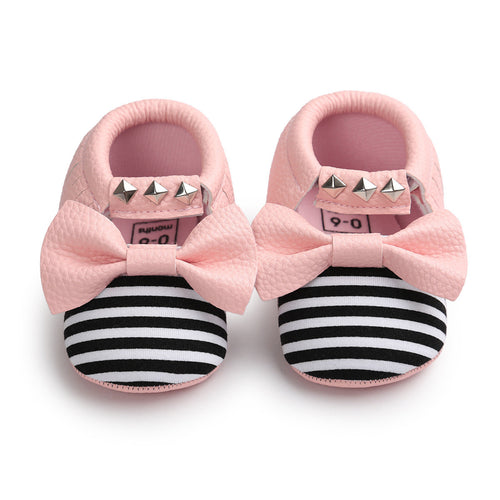 Black and white striped toe with pink bow and silver studs. Baby moccasin shoes.