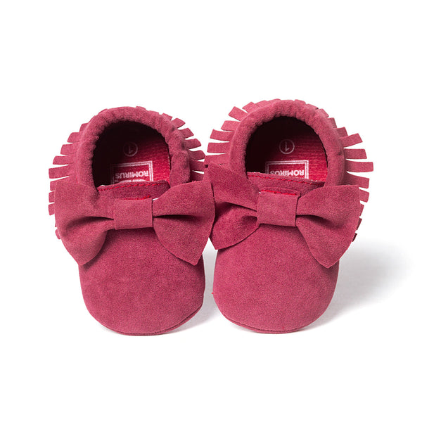 Deep pink colour with bow and tassel trim moccasin baby shoes.
