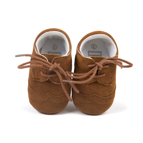Brown lace up fashionable moccasins.