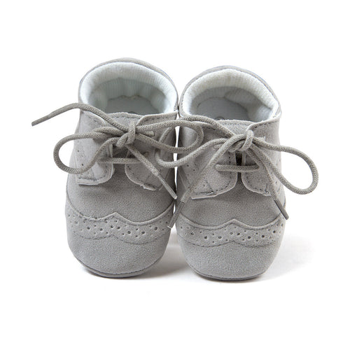 Grey lace up moccasin baby shoes.