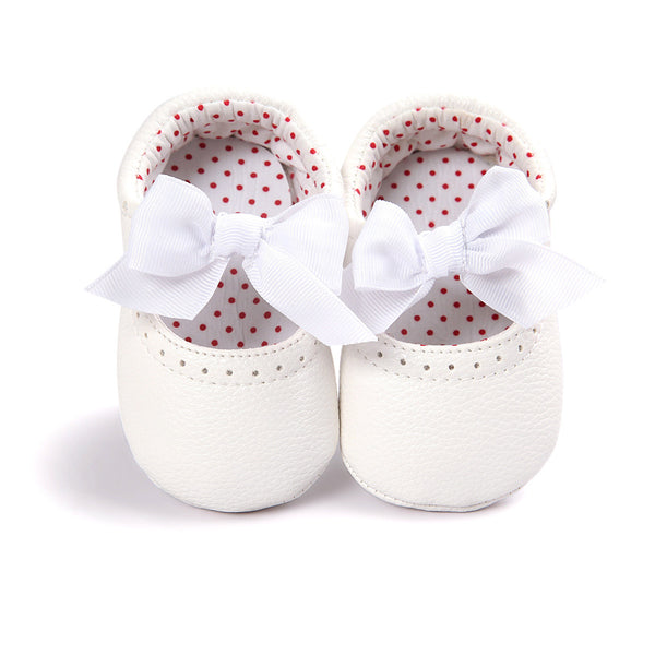 A precious pair of white ballerina moccasins with ribbon bow makes your baby look just gorgeous.