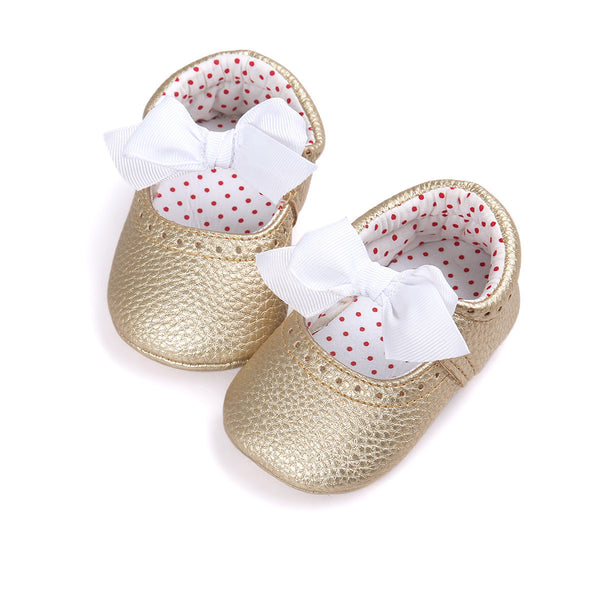 Gold ballerina baby moccasins with white bow. Soft Sole shoe.
