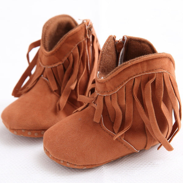 These tan colour cowboy moccasins with trendy frills are perfect for your adorable baby.