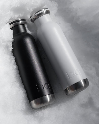 black and white hydration bottle in snow