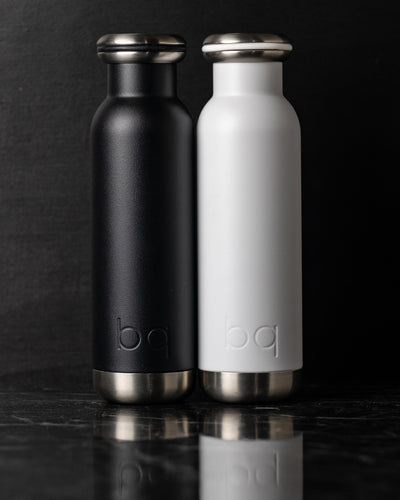 close up black and white bq bottles
