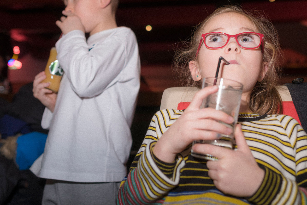 Children with soft drinks at bowling alley