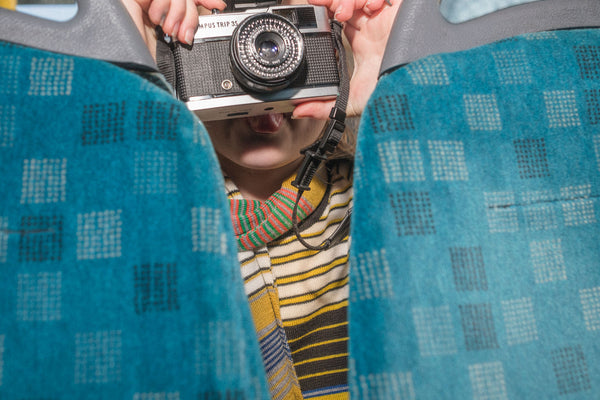 Girl taking a photo on a bus