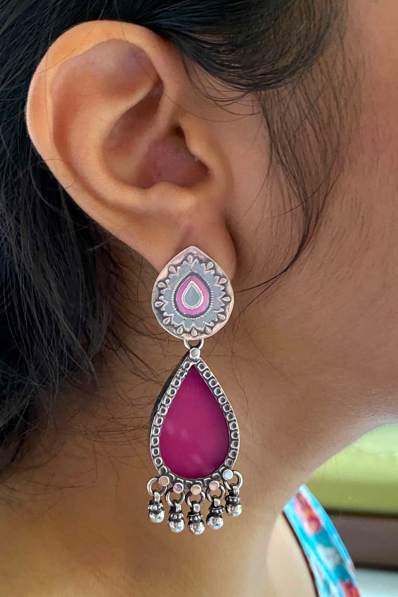 Pink and gray enamel stud with a pink glass enamel drop at bottom
