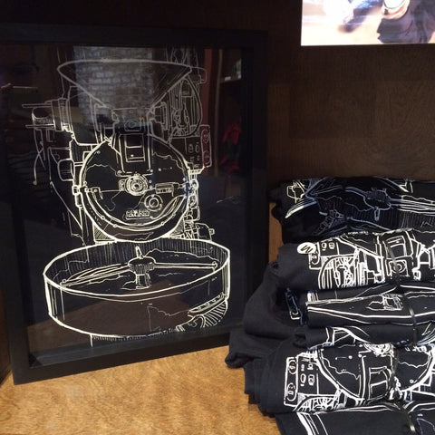 Temple Coffee Retail Display of tee shirts framed and displayed in a Shart T Shirt Frame Display Case