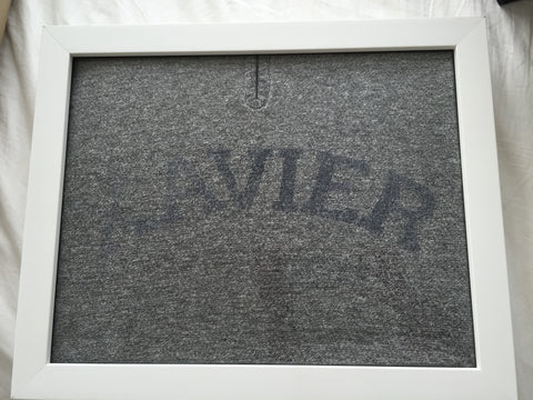 Xavier tee shirt framed and displayed in a Shart T-Shirt Frame Display Case