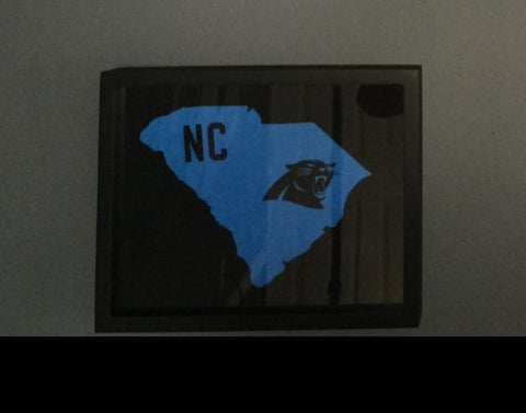 NFL Carolina Panthers tee shirt in a framed and displayed in a Shart T Shirt Frame Display Case, Cam Newton