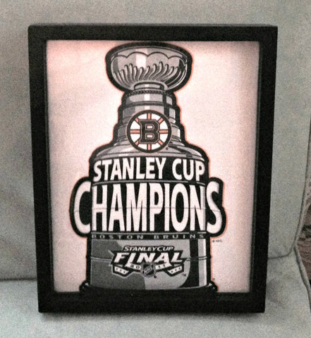 NHL Boston Bruins Stanley Cup Champions tee shirt framed and displayed in a Shart T Shirt Frame Display Case