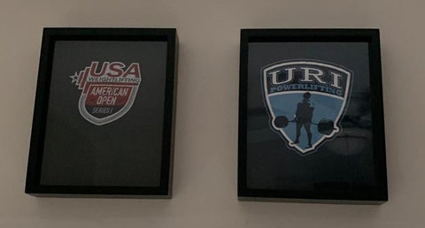 University of Rhode Island Powerlifting Team and USA Weightlifting tee shirts framed and displayed in Shart Original T-Shirt Frames
