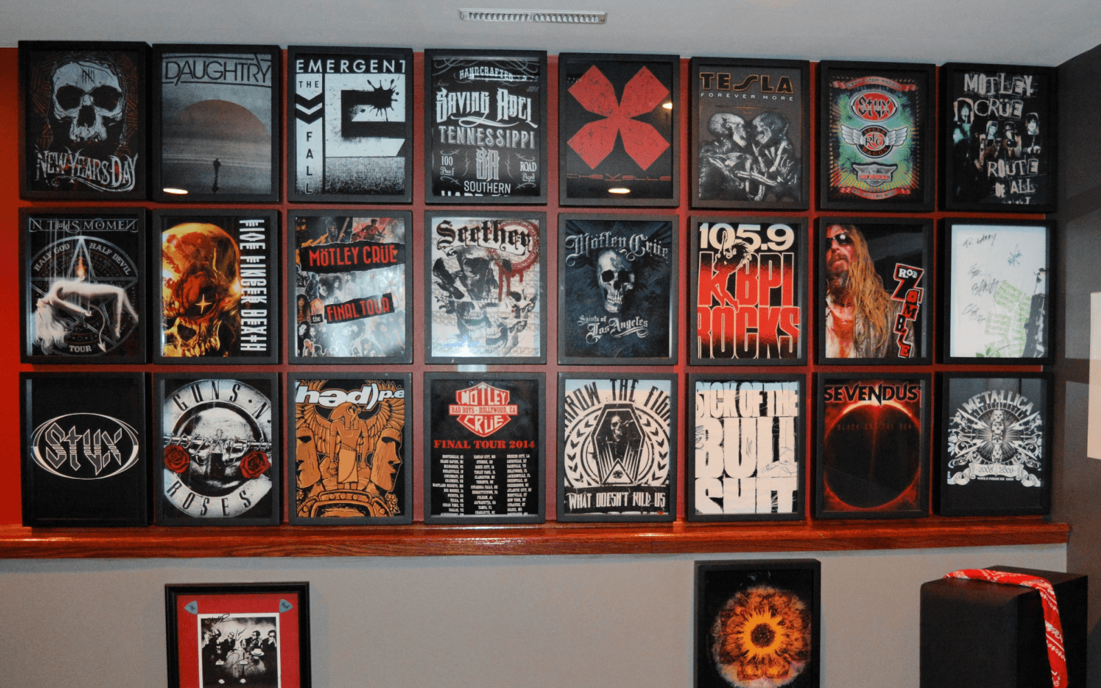 Large Shart T-Shirt Frame Display of Heavy Metal tee shirts in music studio